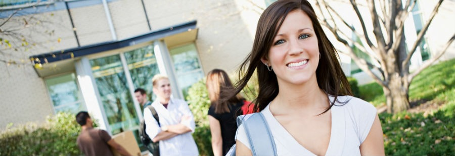 Here are some moving tips for college students - female college student carrying a box